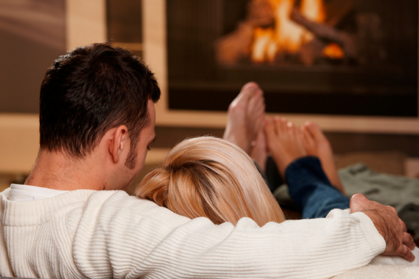 perth insulation couple enjoying warm fire
